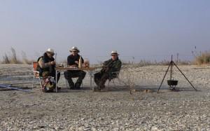 Seniors' picnic on a Black Sea wild beach